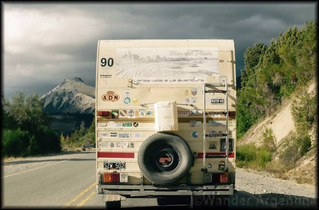 A camper van with mountains in the distance on the Seven Lakes Route of Route 40 in Patagonia Argentina