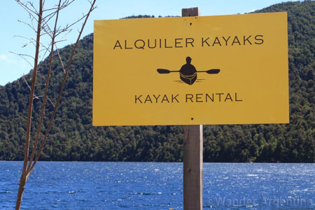 A sign advertising kayak rental on Lake Nahuel Huapi in Patagonia, Argentina