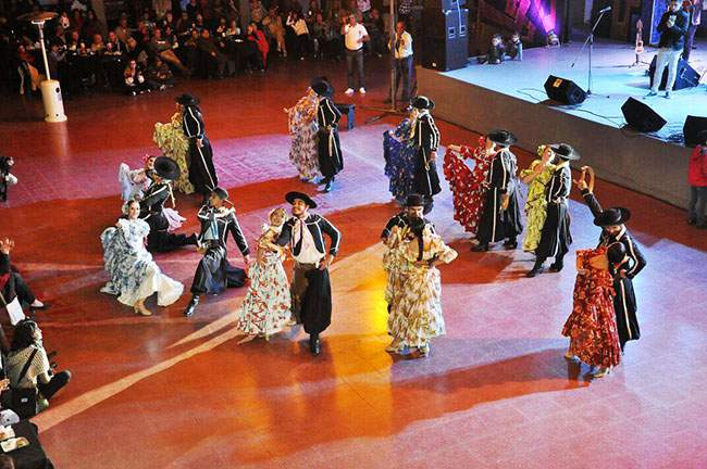 Argentine Folklore dancers on stage at the Cosquín National Follore Festival