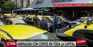 Taxi drivers stage a roadblock in Buenos Aires to protest Uber.