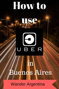 A show of a highway at night with words in overlay which say 'How to Use Uber in Buenos Aires'