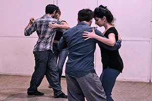 Two couples practice tango in a Buenos Aires tango class