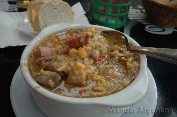 A bowl of locro, a popular corn, bean and meat stew served on national holidays in Argentina