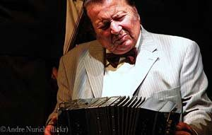 A bandoneon player on stage at the La Ventana Tango Show