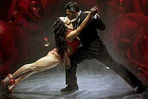 A pair of tango dancers do an acrobatic move at the Señor Tango Show.