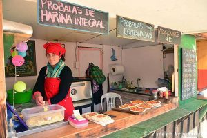 A woman prepares food at Bariloche's Swiss Village weekly outdoor artisanal fair