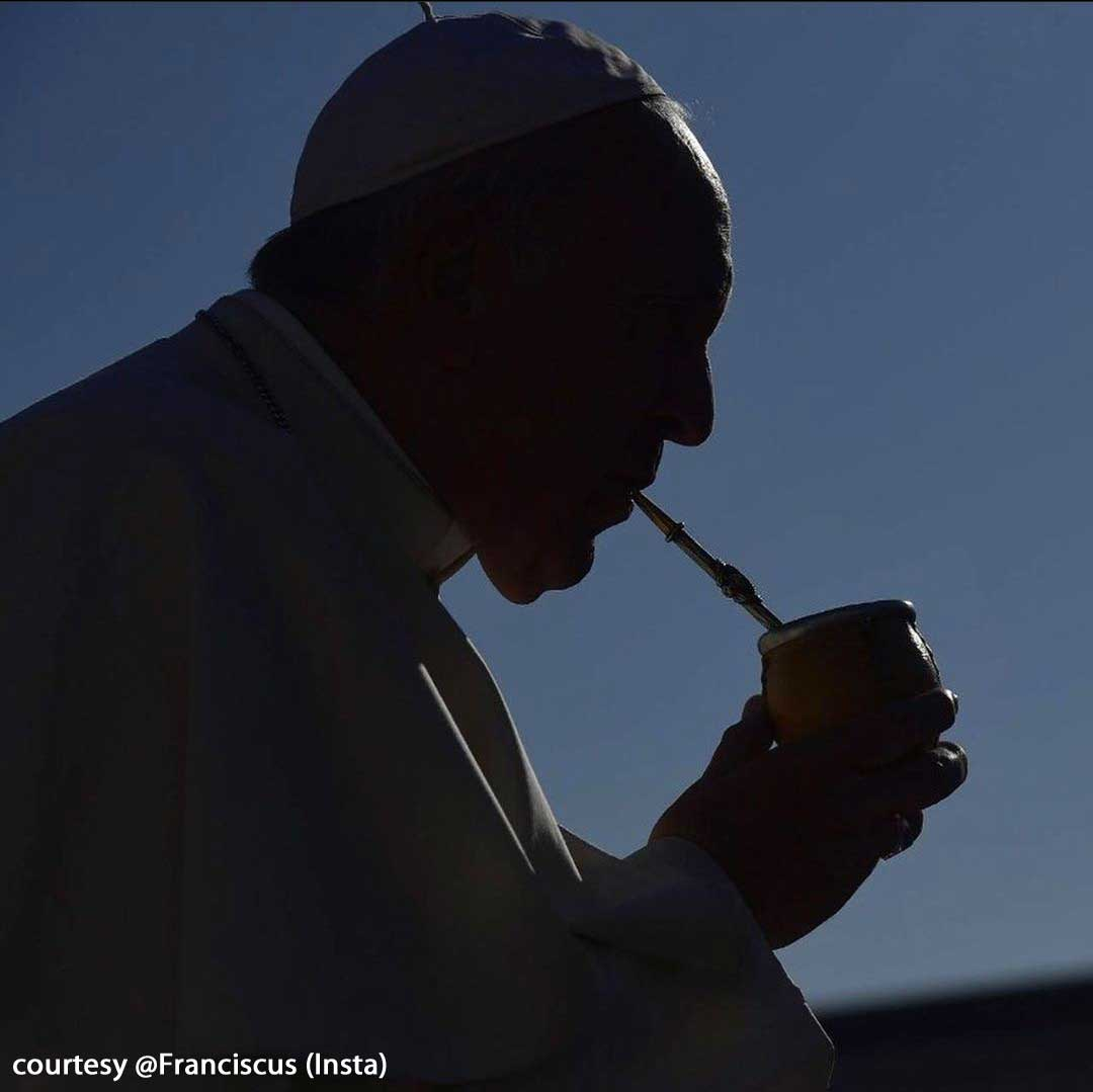 Pope Francis drinking mate as a silhouette